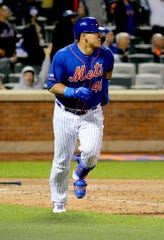 Mets catcher Wilson Ramos hits a solo home run against the Detroit Tigers during the eighth inning at Citi Field on Friday, May 24.