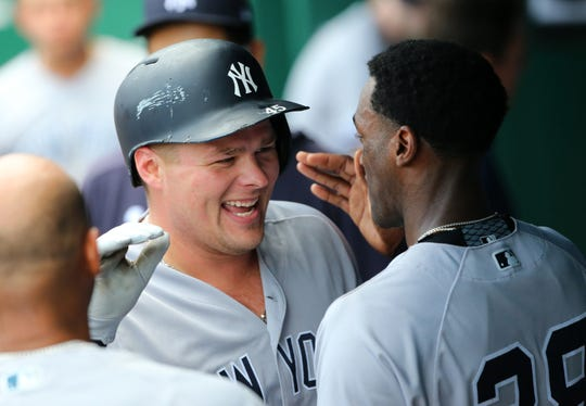 May 25, 2019; Kansas City, MO, USA; New York Yankees first baseman Luke Voit (45) is congratulated by right fielder Cameron Maybin (38) after hitting a home run against the Kansas City Royals during the sixth inning in the first game of a double header at Kauffman Stadium.