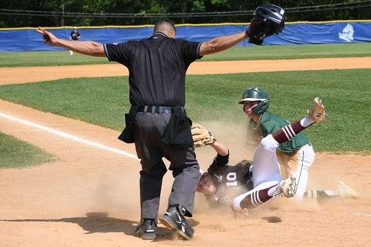 Ridgewood vs. St. Joseph in the Bergen County baseball tournament championship game on Saturday, May 25, 2019. RW pitcher SJ #19 Anthony Panissidi is save at home as RW #10 pitcher Matt Crawford tries to get the out.