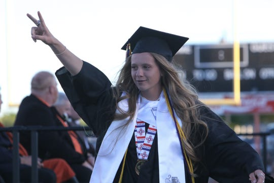 Hailey Funk leaves the stage after speaking as part of the Honor Graduate Reflection.