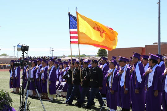 The Kirtland Central High School Honor Guard perform the Presentation of Colors during the May 25 commencement ceremony at Bill Slade Stadium.
