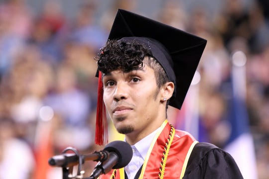 Graduate Shane Tate speaks during the College of the Desert commencement ceremony at the Indian Wells Tennis Garden in Indian Wells on Friday, May 24, 2019.