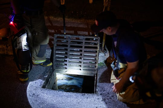 A bluish material is seen inside an open storm drain after it leaked into storm drains around the 500 block of East Middle St. and into a small stream that runs behind Factory St., Friday, May 24, 2019, in Hanover Borough. York County Hazmat Chief Ray Kinsey said residents shouldn't be concerned as it has not harmed wildlife, and the material appears to be some kind of lubricant from one of the factories on East Middle St.