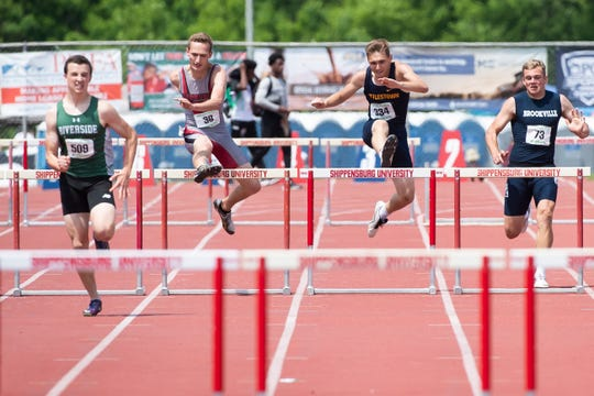 Bermudian Springs' Payton Rohrbaugh and Littlestown's Derek Herr leap over hurdles in adjacent lanes in the 2A 110m hurdles finals during the PIAA track and field championships at Shippensburg University on Saturday, May 25, 2019.