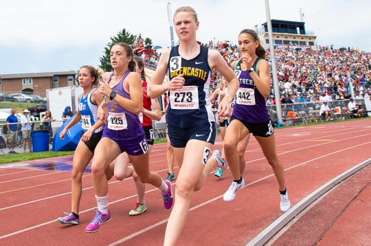 Greencastle-Antrim junior Taryn Parks (273) leads the pack in the 3A 1600m run as Northern's Marlee Starliper (442) follows close behind during the PIAA track and field championships at Shippensburg University on Saturday, May 25, 2019. Parks and Starliper, the number one and two 1600m runners in the nation, respectively, finished within 0.38 seconds of one another.
