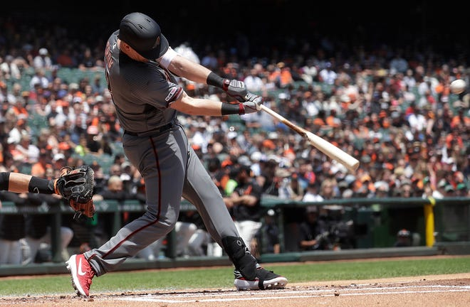 Arizona Diamondbacks' Kevin Cron hits into a double play to score Ildemaro Vargas against the San Francisco Giants during the first inning of a baseball game in San Francisco, Saturday, May 25, 2019.