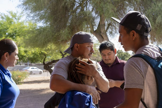 Migrants are reunited with family members at Iglesia Cristiana El Buen Pastor church in Mesa on May 24, 2019, after being released from a U.S. Immigration and Customs Enforcement detention center.