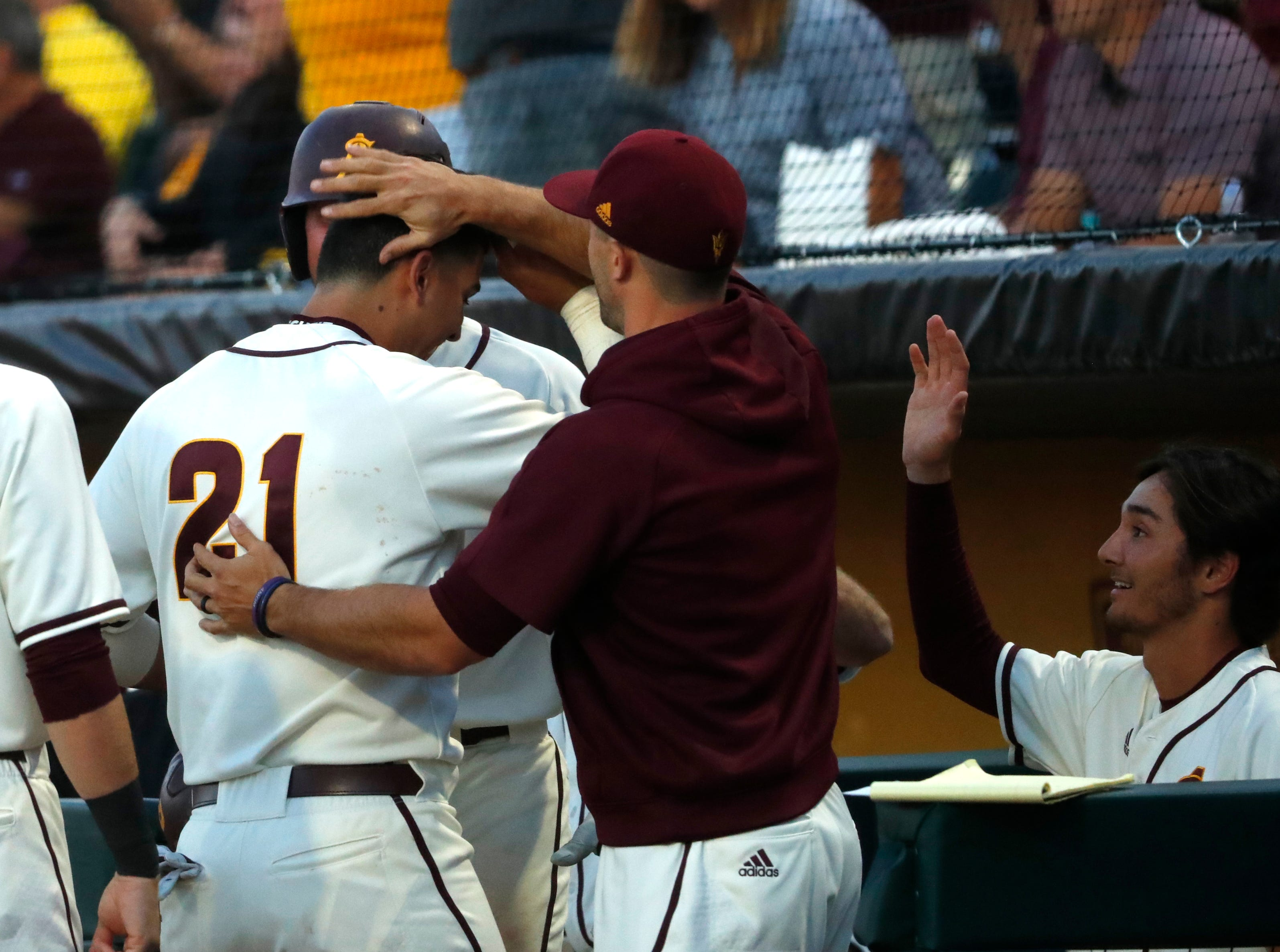 ASU's Carter Aldrete (21) celebrates in the dugout after hitting a home run against Stanford during the sixth inning at Phoenix Municipal Stadium in Phoenix, Ariz. on May 24, 2019.