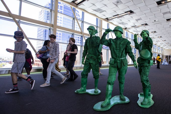 From left: Daniel Greco, Hazel McGuffin, and Wendy Woodward pose as toy soldiers during Day 3 of Phoenix Fan Fusion on Saturday, May 25, 2019, at the Phoenix Convention Center in Phoenix.