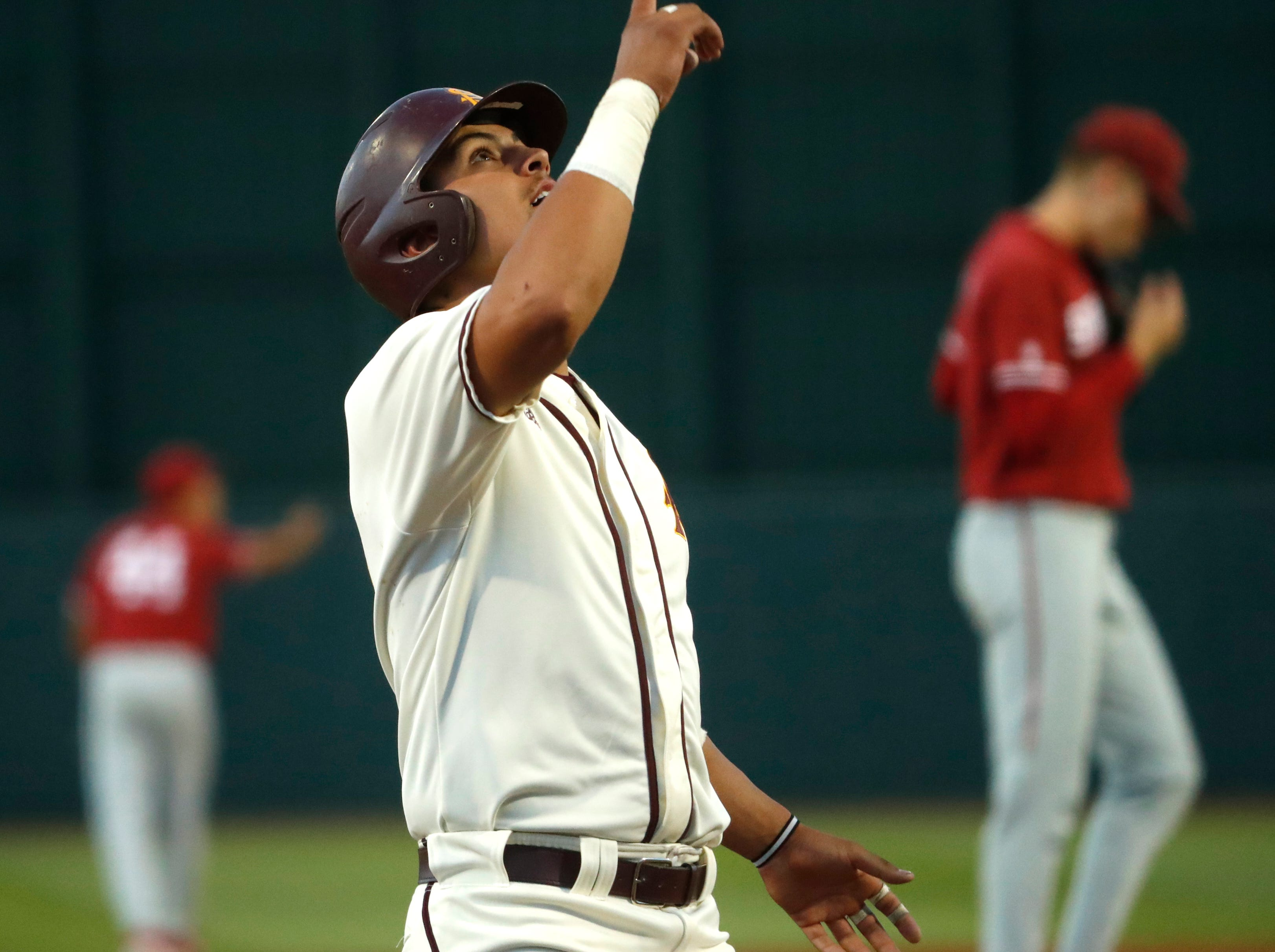 ASU's Carter Aldrete (21) celebrates at home after hitting a home run against Stanford during the sixth inning at Phoenix Municipal Stadium in Phoenix, Ariz. on May 24, 2019.
