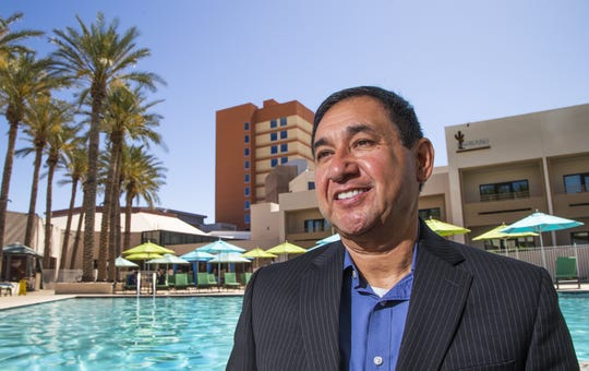 Robert Miguel, chairman of the Ak-Chin Indian Community, stands poolside at the Harrah's Ak-Chin Hotel and Casino in Maricopa. The resort is celebrating 25 years.