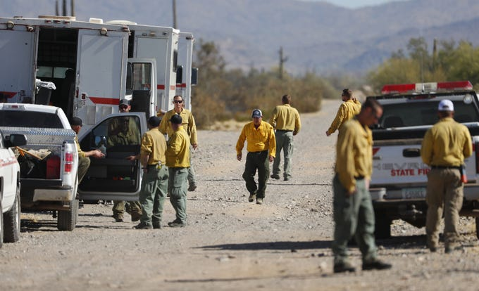 Fire personnel prep as they respond to the Dove Fire on a road near Dove Valley Road in Surprise, Ariz. on May 25, 2019.