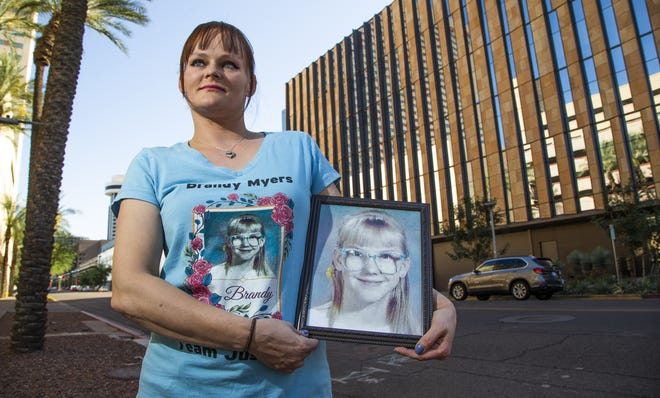 Kristin Thelen, 38, of Mesa, holds a photo of her sister, Brandy Myers, who disappeared on May 26, 1992, from their Sunnyslope neighborhood. Brandy has never been found.