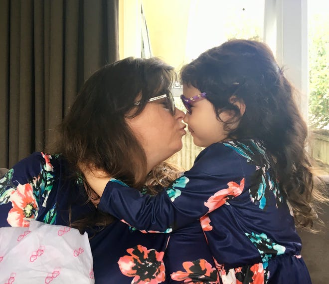 """My """"cuzzie"""" Tiffany Clarke and her daughter, Talia, 3, wear """"sunnies."""""""