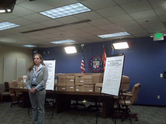 "In this image from July 6, 2010, Maricopa County spokeswoman Cari Gerchick stands in front of dozens of boxes of county financial records obtained after months of legal wrangling, and officials spending an estimated $100,000. County officials had said Sheriff Joe Arpaio may have misspent money, but needed detailed receipts and other records to determine how much - if any. Management and Budget ""will be taking a very careful and detailed look"" at the records, Gerchick had said. ""We don't know what we will find."""