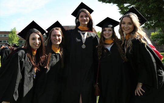 Alyssa Carl (left) Jane Gocha, Hannah Johnson, Emily Hyslip and Jessey Tomlins (right) graduated with bachelors of science on Saturday, May 25, 2019.