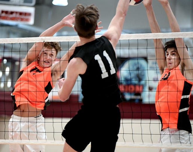 York Suburban's Harrison Perring, left, and Luke Babinchak defend at the net vs. Manheim Central's Brandyn Musser in the District 3 Class 2-A boys' volleyball title match on Friday, May 24. Perring and Babinchak have helped the Trojans to the PIAA Class 2-A championship match. Bill Kalina photo