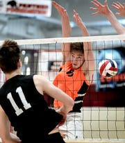 York Suburban's Nate Bowman attempts to block a shot by Manheim Central's Brandyn Musser in the District 3 Class 2-A boys' volleyball title match on Friday, May 24. Manheim Central won that match, 3-0. Suburban turned the tables with a 3-1 win over Manheim Central on Tuesday in a state 2-A semifinal. Bill Kalina photo