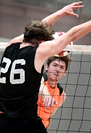 York Suburban's Nate Bowman hits a shot with Manheim Central's Mason Nissley defending in the District 3 Class 2-A boys' volleyball title match on Friday. Bowman and Nissley will be teammates next season at Messiah College.