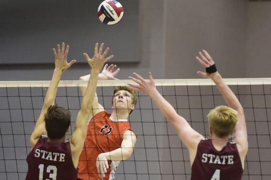 Central York's Braden Richard hits one of his team-high 34 kills in the District 3 Class 3A championship game against State College May 24, 2019.