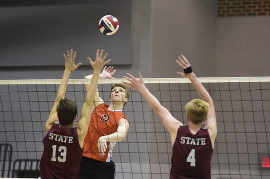 Braden Richard smashes home one of his team-high 34 kills in the District 3 Class 3A championship game Friday, May 24, 2019 at Dallastown. York Suburban defeated State College, 3-1.