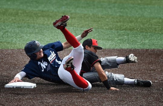 Nevada's Keaton Smith collides with San Diego State's Jacob Maekawa on a play at second base Friday at Peccole Park.
