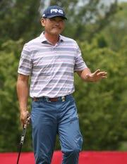 Ken Tanigawa waves after his birdie putt on 9 at the Senior PGA at Oak Hill.