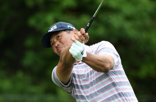 Ken Tanigawa tees off on the third hole Saturday morning at Oak Hill Country Club.