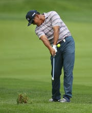 Ken Tanigawa hits his second shot from the 16th fairway during the third round of the Senior PGA Championship at Oak Hill Country Club.
