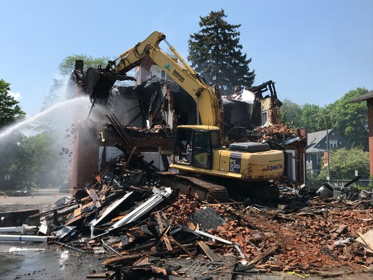 Demolition of 252 S. Plymouth Ave. began mid-afternoon Saturday, May 25, 2019, after an early morning fire.