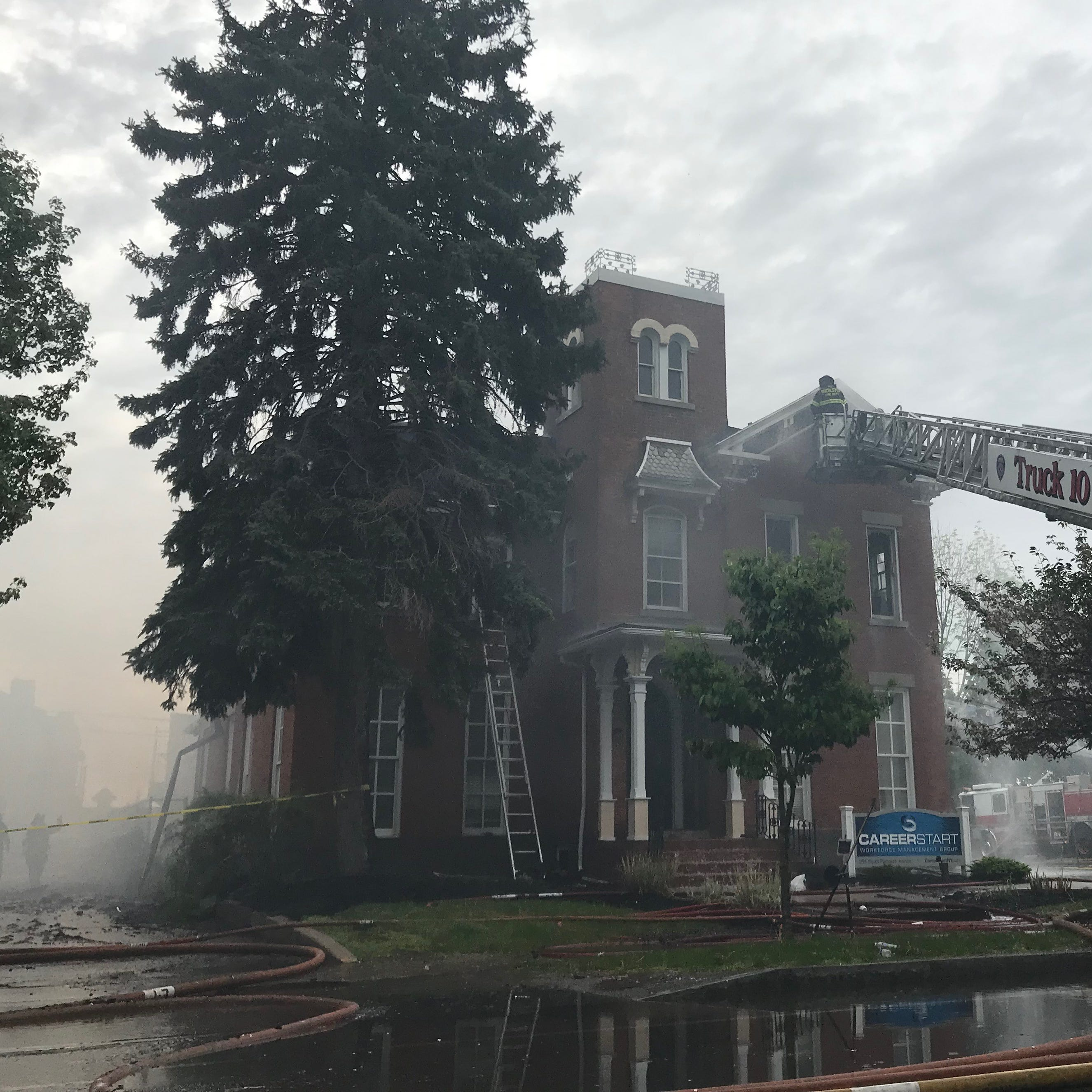 Demolition of historic South Plymouth Ave. building begins after early morning fire