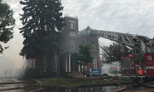 Fire severely damaged a historic building at 252 S. Plymouth Ave. on Saturday, May 25, 2019.