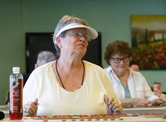 Fay Cornell plays bingo in the community room at the Tree House Senior Apartments on Saturday, May 25, 2019. Her search for affordable senior housing led her to the complex in north Redding.