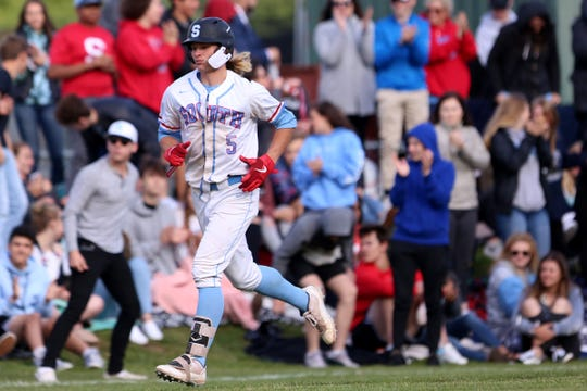South Salem's Ryan Brown (5) makes his way to home plate after hitting a home run during the South Salem vs. West Linn baseball game in the quarterfinals of the OSAA class A state tournament at Gilmore Field in Salem on May 24, 2019.