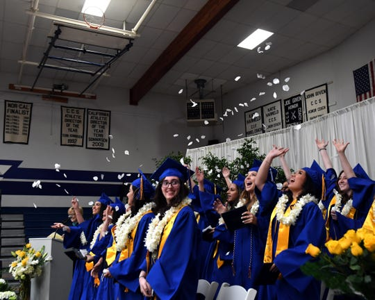 Students throw white rose petals in the air after being pronounced graduates of Notre Dame High School. May 25, 2019.