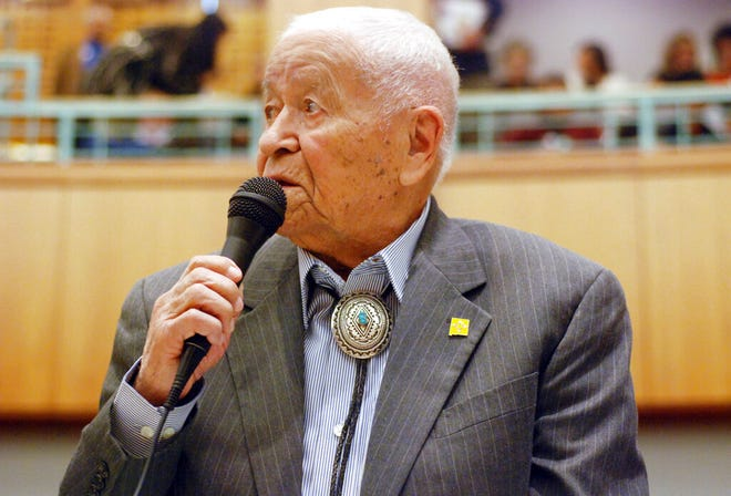 "In this Feb. 2, 2018, file photo Democratic New Mexico state Sen. John Pinto talks about his career as a lawmaker on American Indian Day in the Legislature on  in Santa Fe, N.M. Pinto joined the Senate in 1977 and is 92 years old. He was a Marine who trained as a Navajo code talker during World War II. His singing of the ""Potato Song"" is an annual Senate ritual."