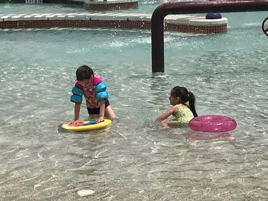 Avery Henry (left) plays with Maribelle Vega (right) at Municipal Pool Saturday, May 25, 2019.