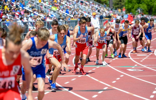Competitors line up for the 3200 meter run during the second day of the state high school track and field meet Saturday, May 25, at Howard Wood Field in Sioux Falls.