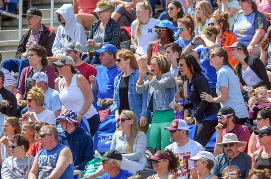 Spectators in the densely-packed bleachers cheer on the athletes during the second day of the state high school track and field meet Saturday, May 25, at Howard Wood Field in Sioux Falls.