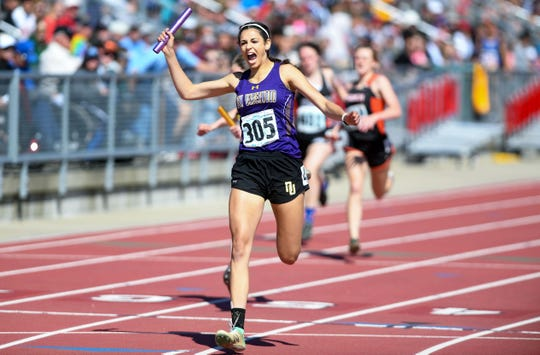 Cerington Jones of New Underwood yells with joy as she crosses the finish line to win the B girls 4x200 relay during the second day of the state high school track and field meet Saturday, May 25, at Howard Wood Field in Sioux Falls.