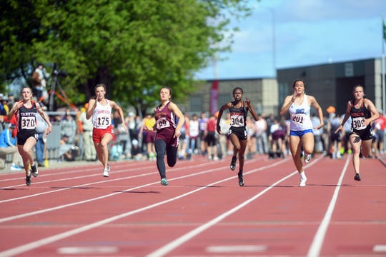 Athletes compete in the AA girls 100 meter dash during the second day of the state high school track and field meet Saturday, May 25, at Howard Wood Field in Sioux Falls.