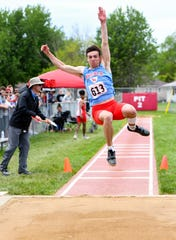 Hunter Merkley competes in the long jump finals during the second day of the state high school track and field meet Saturday, May 25, at Howard Wood Field in Sioux Falls.
