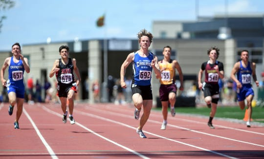 Jacob Hyde of St. Thomas More pulls ahead in the 200 meter dash during the second day of the state high school track and field meet Saturday, May 25, at Howard Wood Field in Sioux Falls.