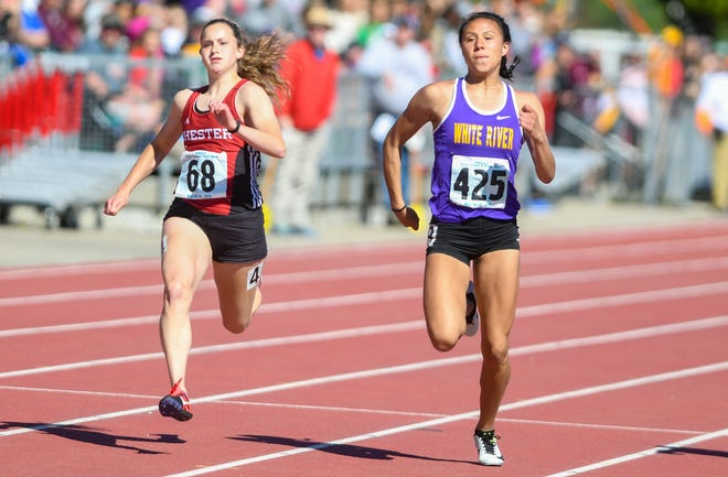 Caelyn Valandra-Prue of White River passes Makenna Larson of Chester Area in the 100 meter dash at the state high school track and field meet Saturday, May 25, at Howard Wood Field in Sioux Falls.