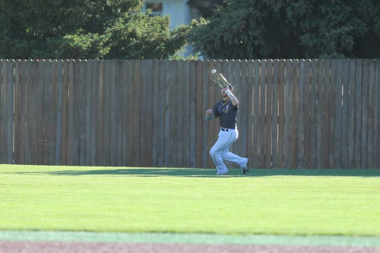 Augie outfielder Nate Crossman catches a fly ball during Friday's game