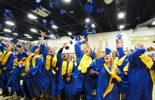 Mortarboards filled the air Friday night as 95 of Cathedral High School's newest graduates celebrated the end of commencement in the school's gym.