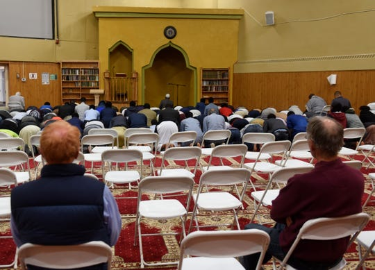Attendees of a community iftar watch evening prayer Friday, May 24, at the Islamic Center of St. Cloud.
