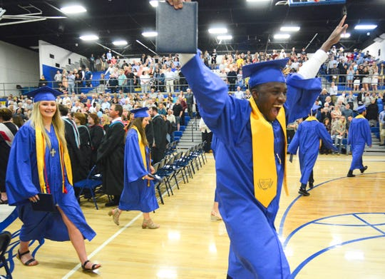 Emotions were high as the Cathedral High School Class of 2019 exit in the recessional.