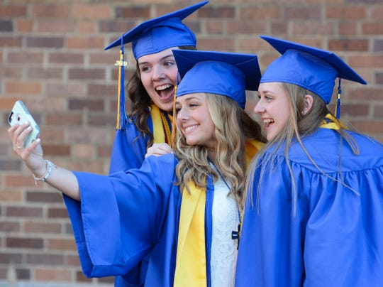 There were plenty of selfies taken Friday before graduation outside Cathedral High School.
