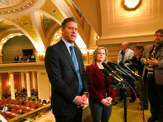 Republican Minnesota House Minority Leader Kurt Daudt, left, joined by Republican Deputy Minority Leader Anne Neu, right, speaks to reporters above the House chamber Friday in the state Capitol in St. Paul.
